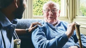 Older man and a carer