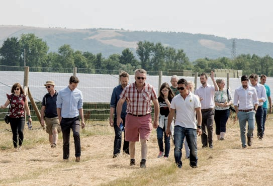 Community workers waling through a field