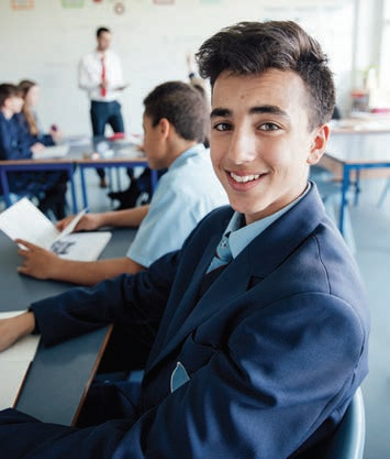 School pupil smiles for the camera