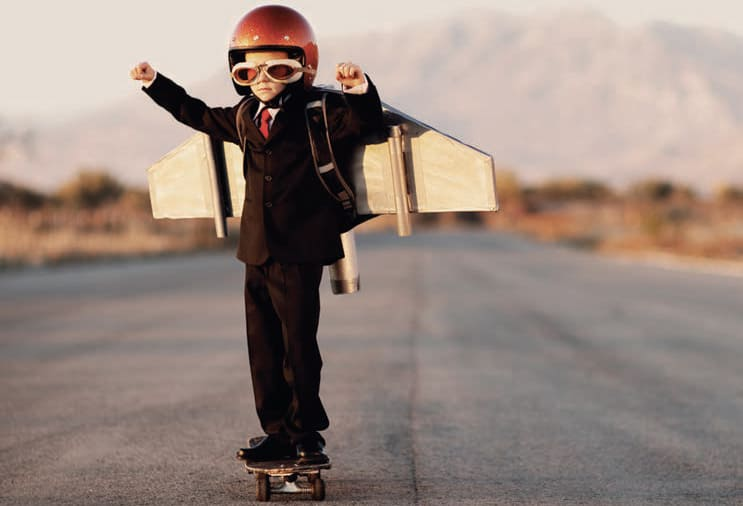Boy on a skateboard ready 'to fly'.