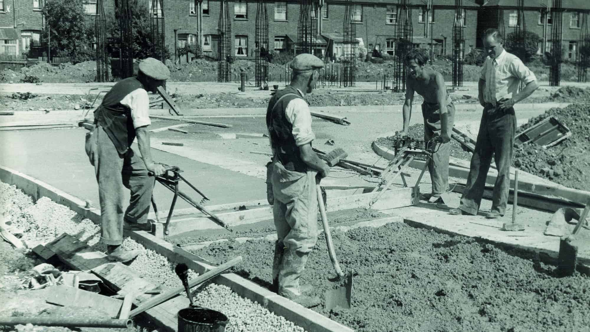 Dated photo of men initially building council homes