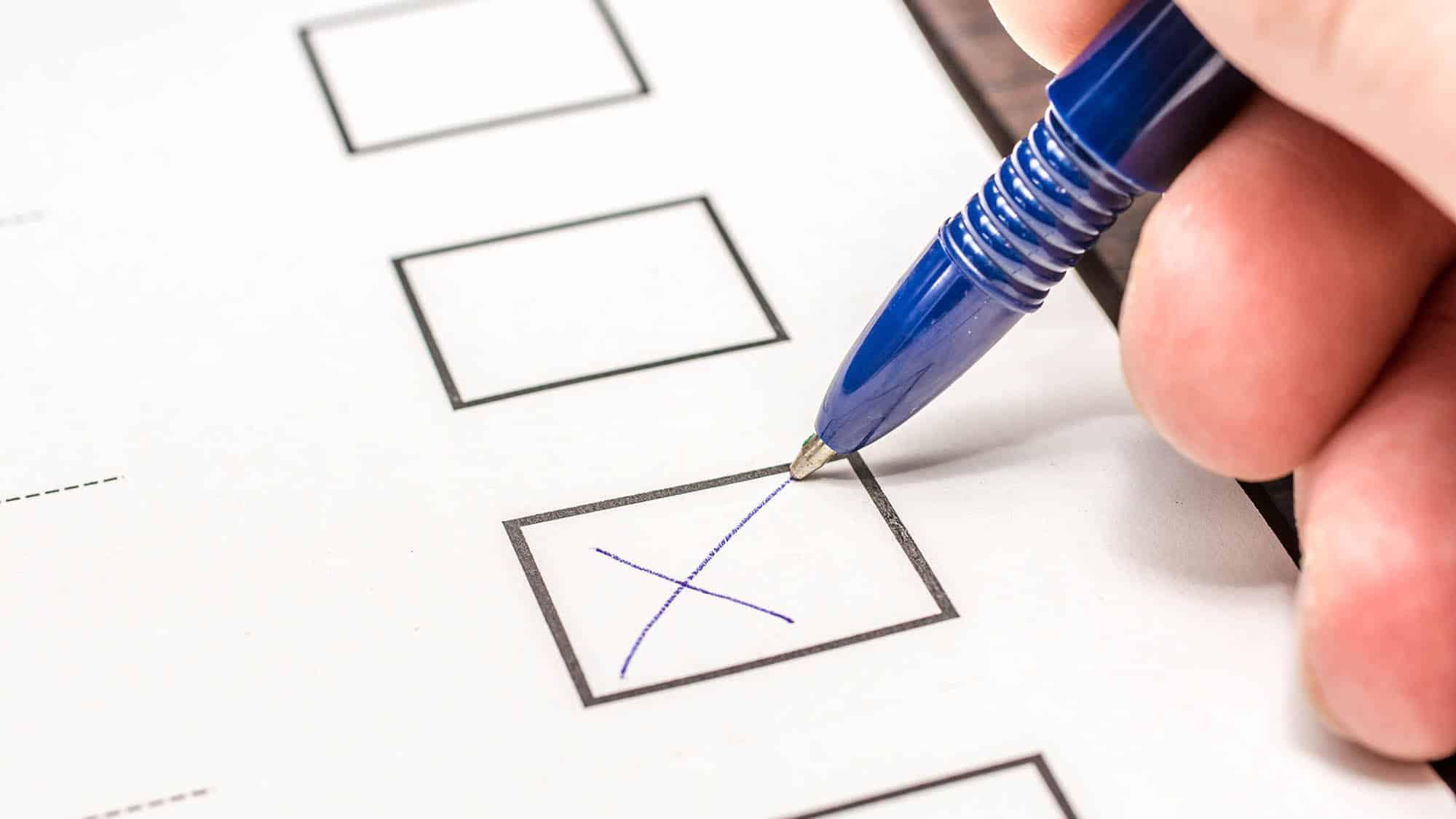A pen ticking a cross in a ballot