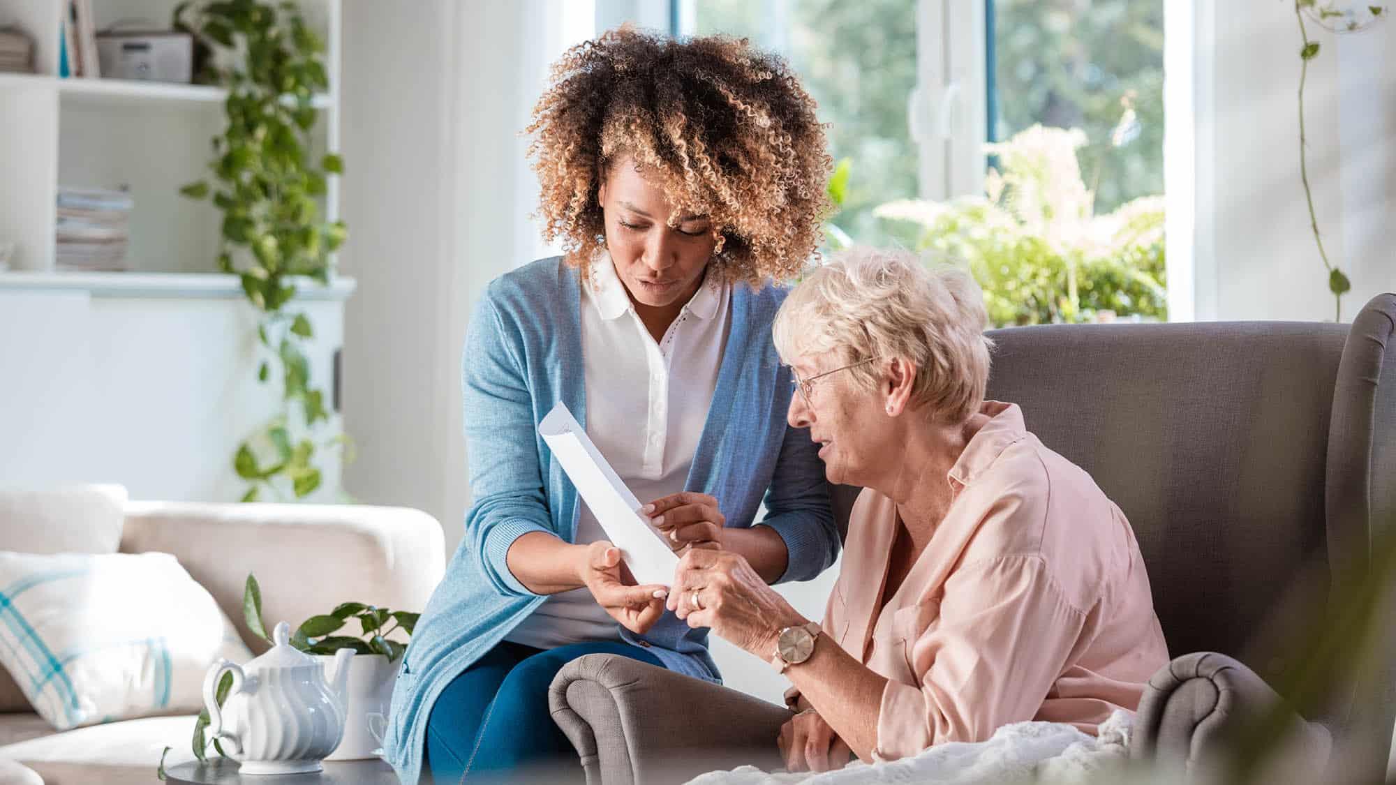 Home nurse taking care of senior woman