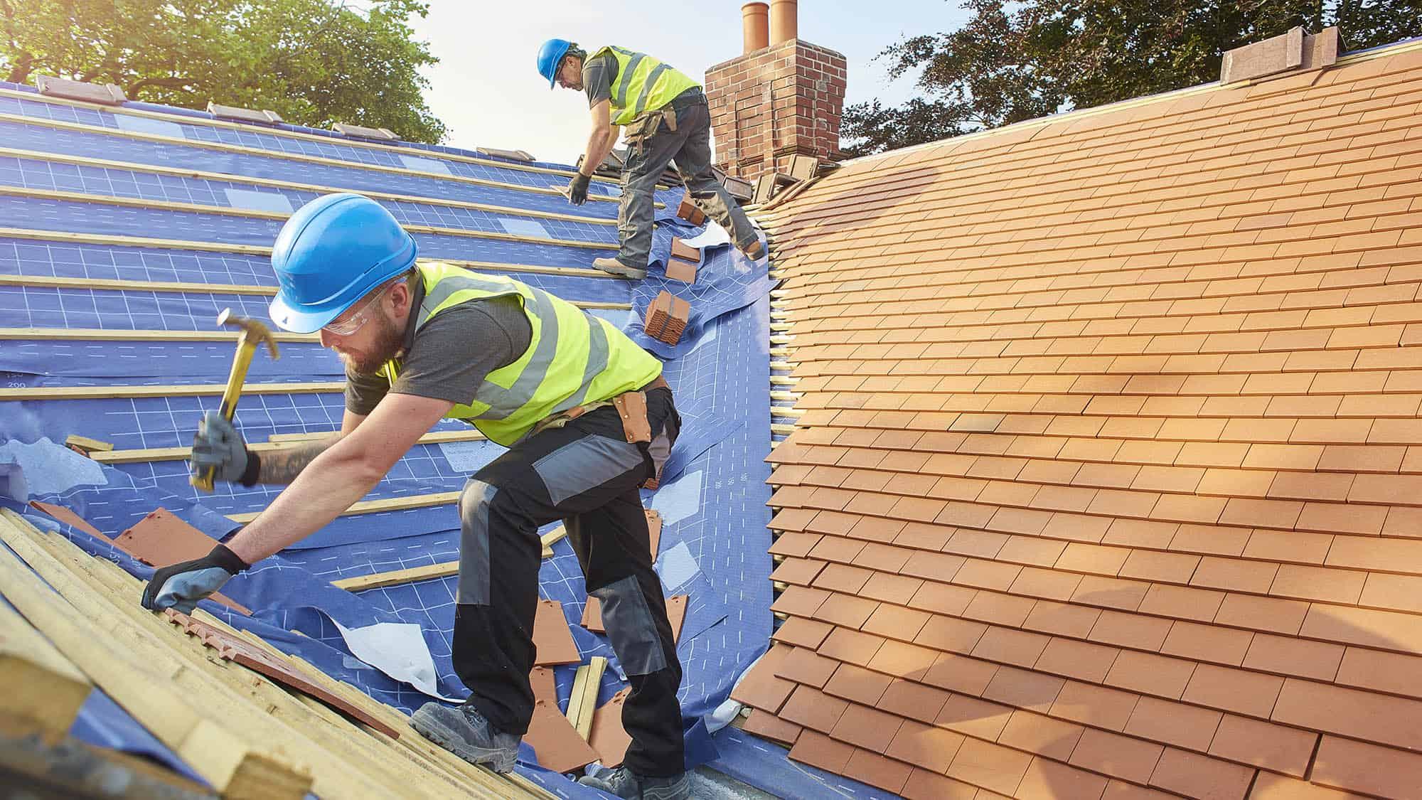 Builders working on a roof installation