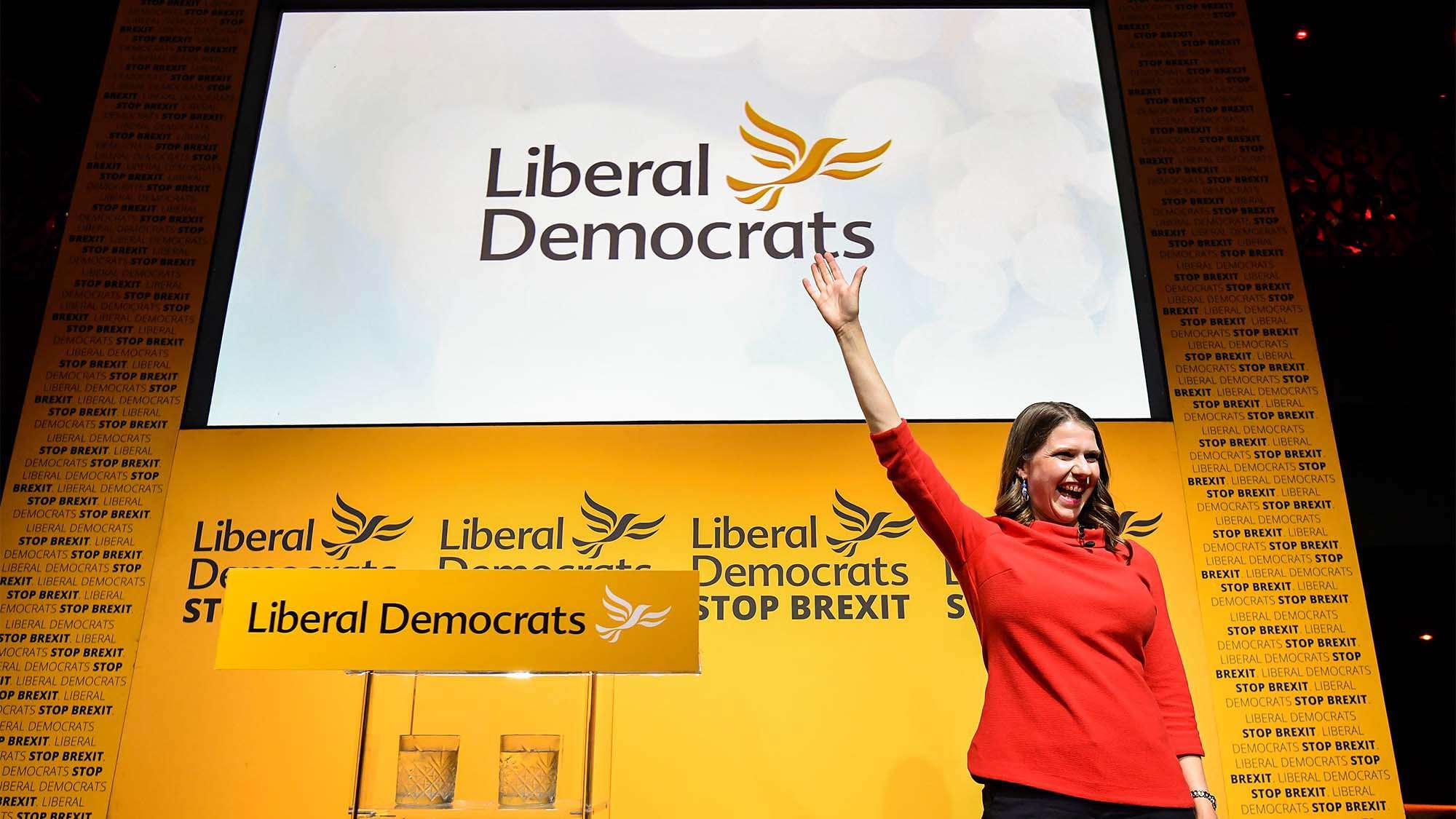 Jo Swinson at Liberal Democrats conference waving and smiling