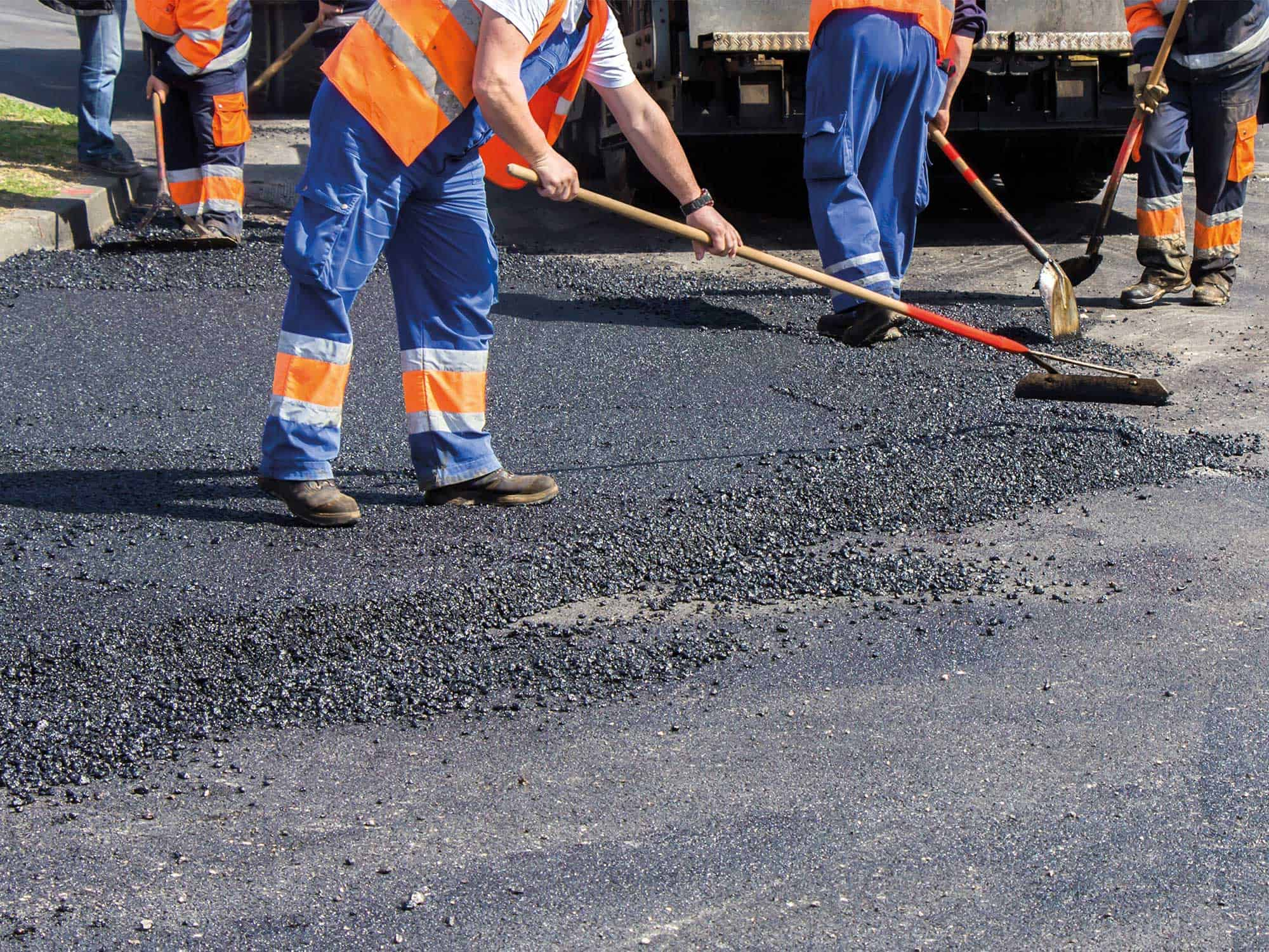 Road workers tarmacking