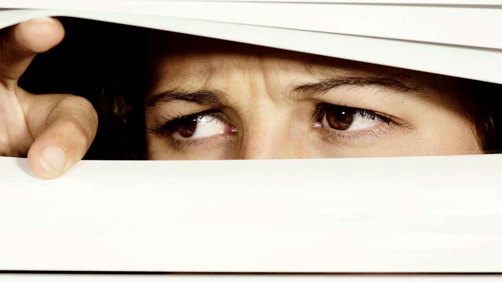 Peeking through a blind