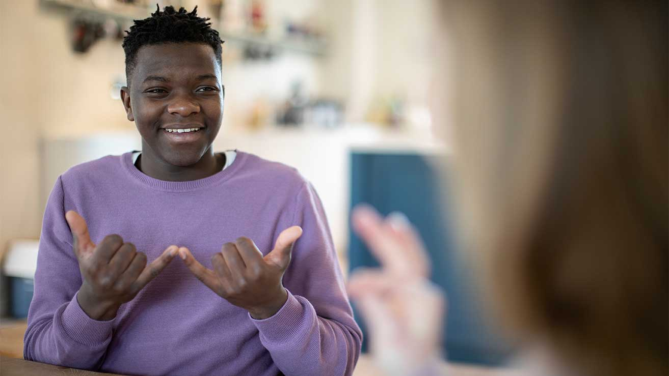 Young man communicating with sign language