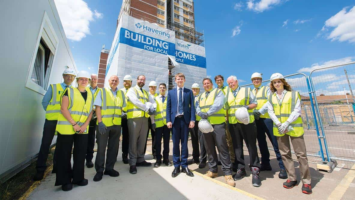 Group of builders standing in front of their work
