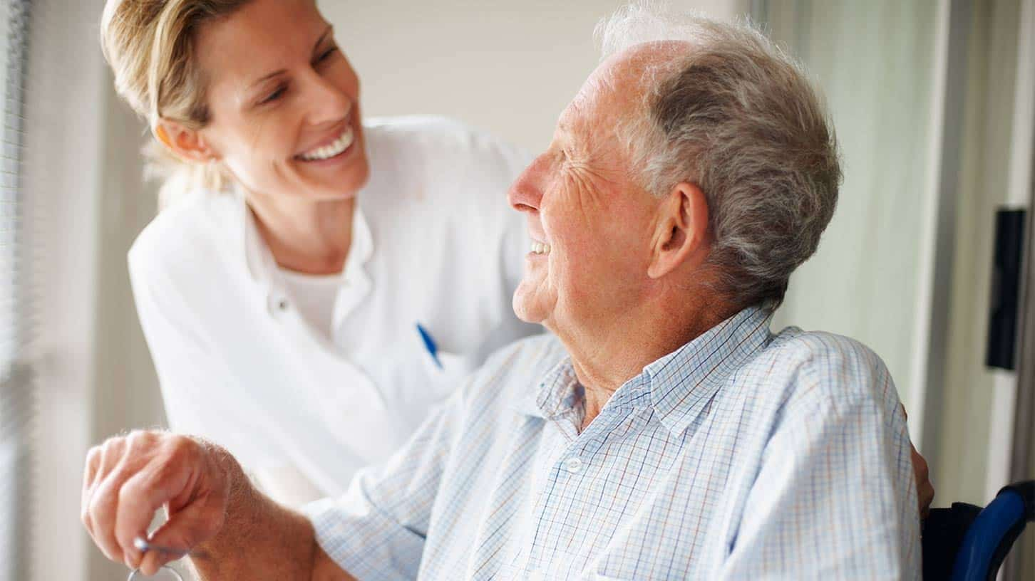 Older man and a care worker talking
