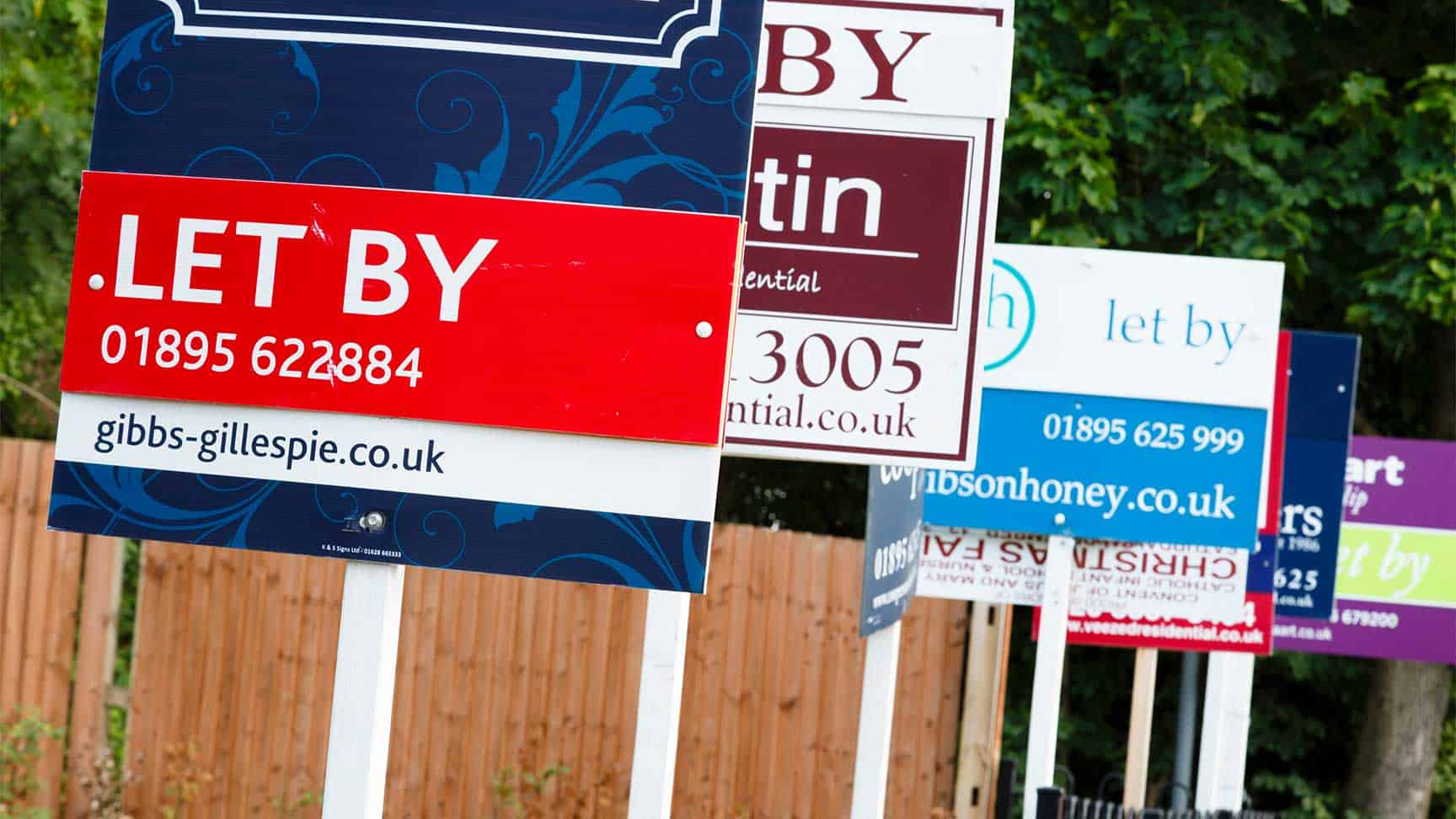 Estate agent's for sale signs in a row