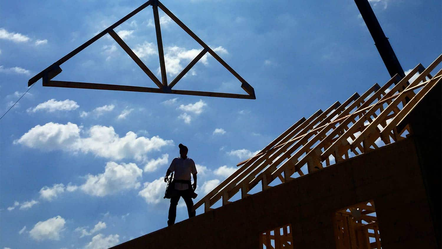 Silhouette of a man on a construction site