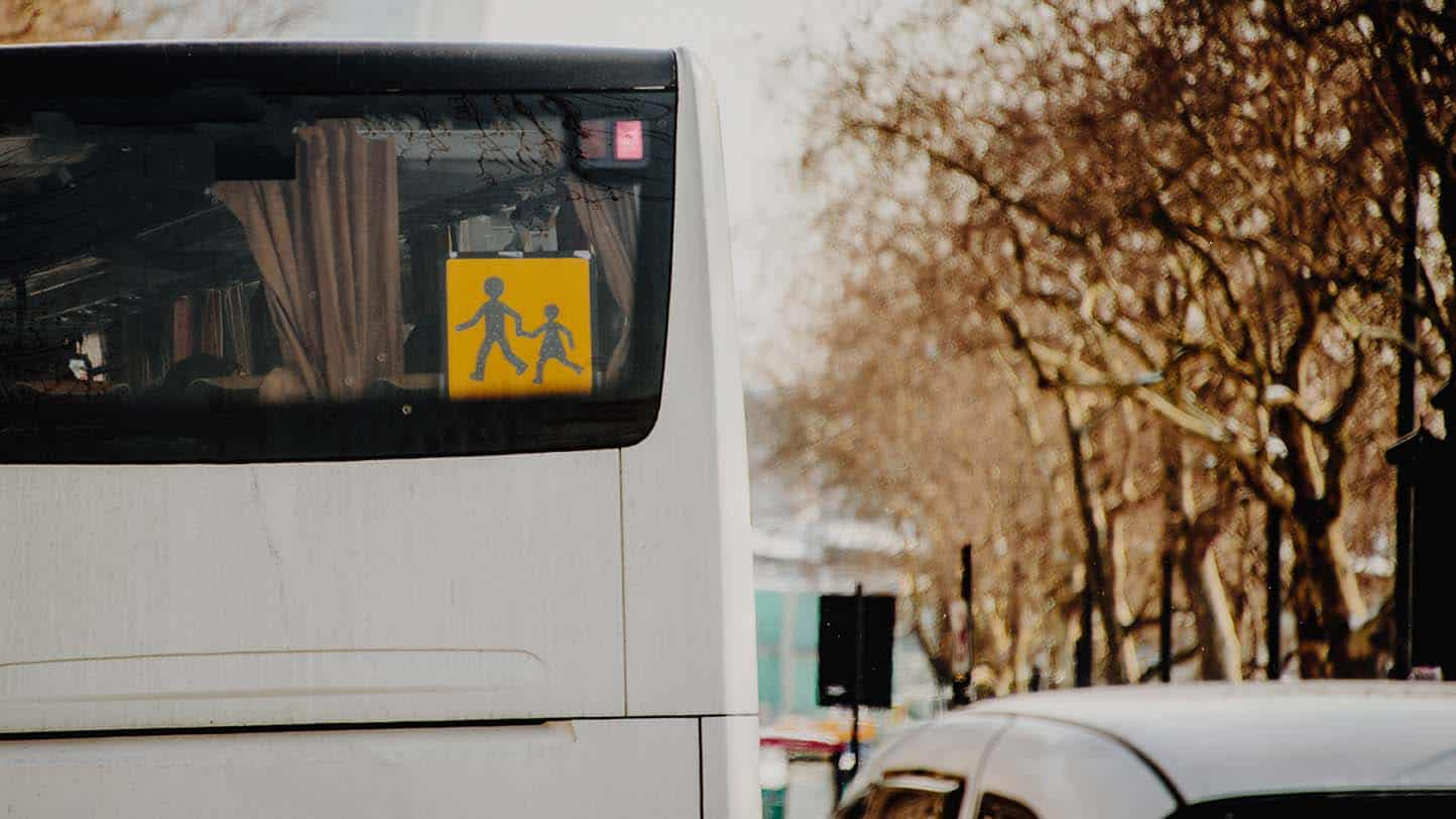 A school service bus sign in the rear of a bus