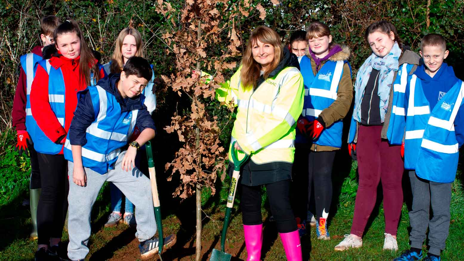 Children planting trees in Cornwall Forest