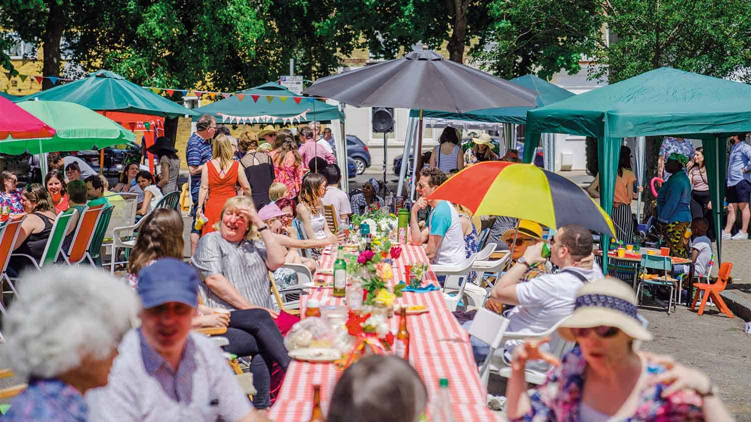 The community enjoying a picnic lunch together