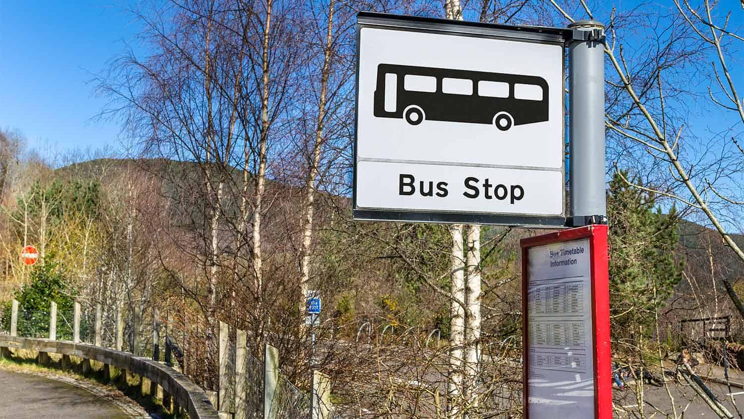 A rural bus stop sign