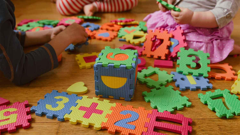 Children's puzzle pieces on floor