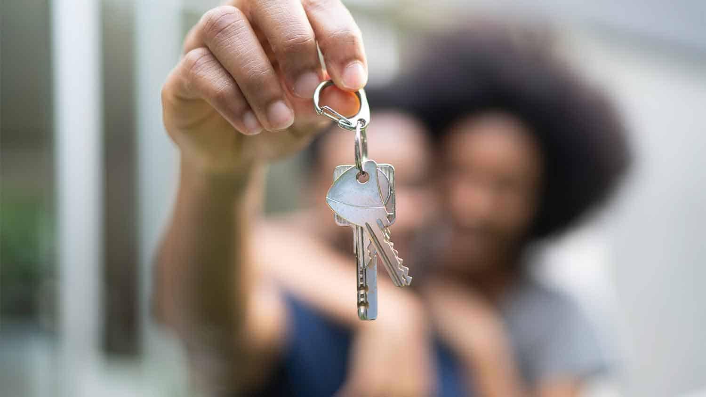 Woman dangling a set of keys