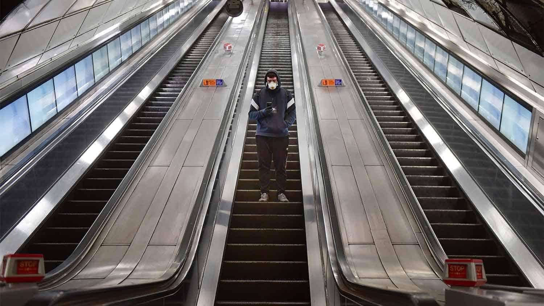 Man stood on an escalator