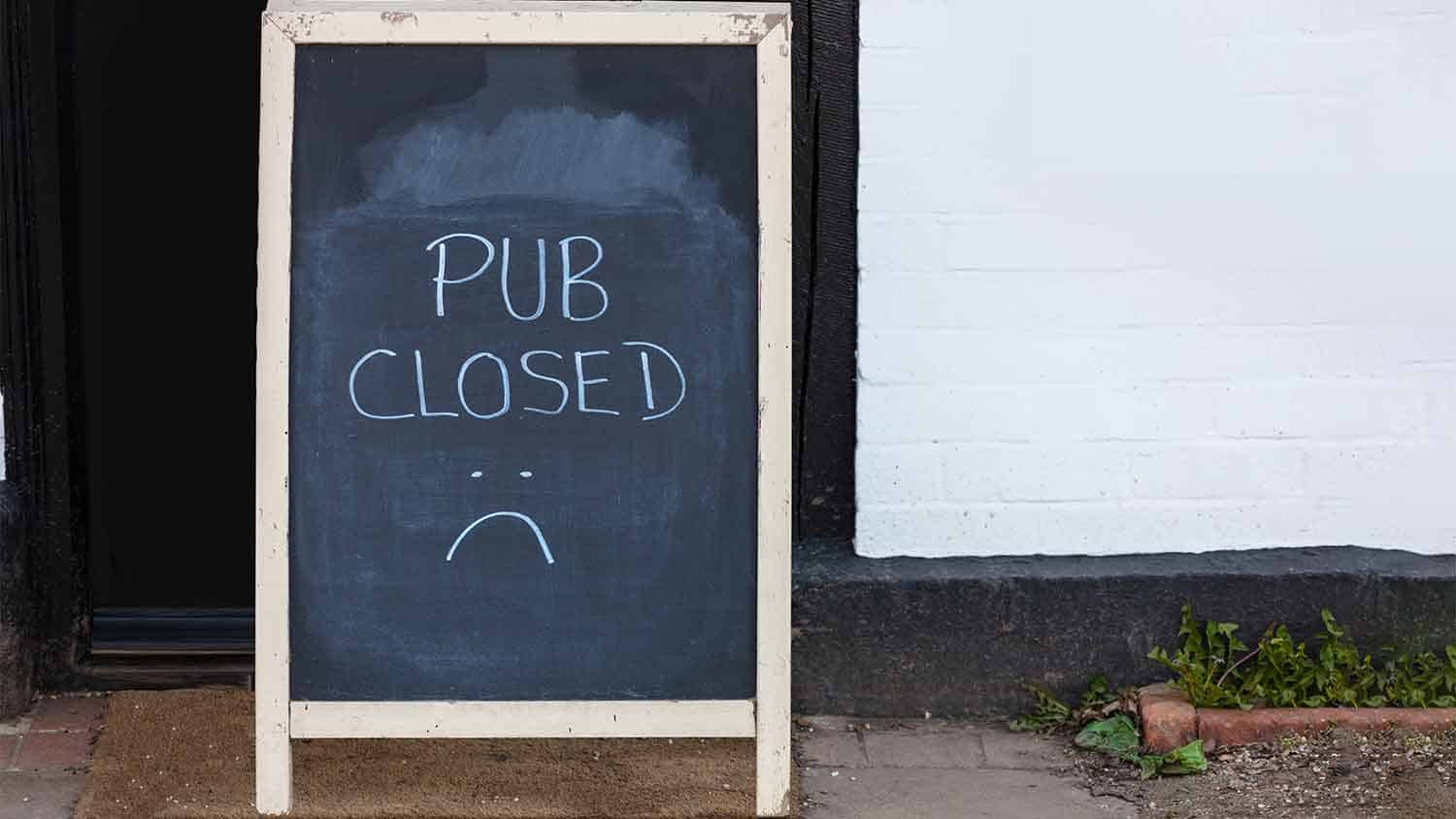 A sign saying 'pub closed'