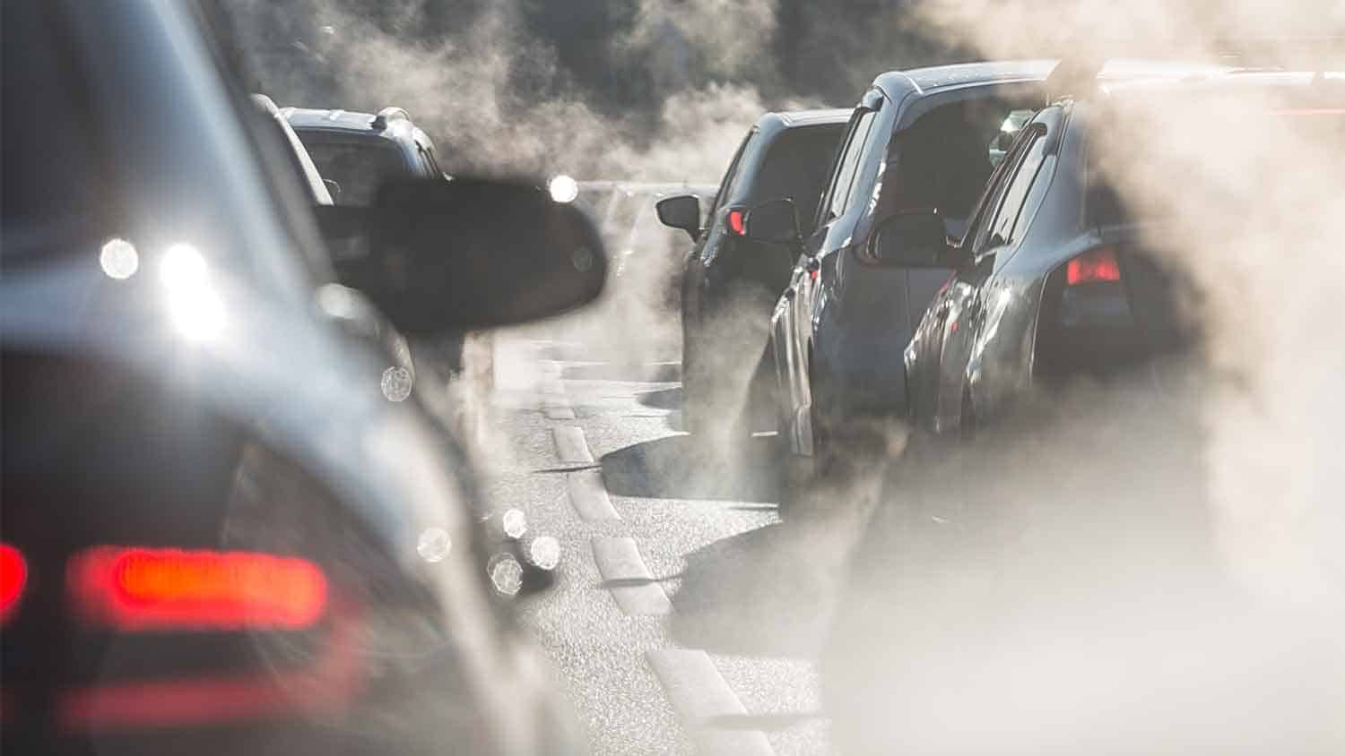 Cars and visible exhaust fumes