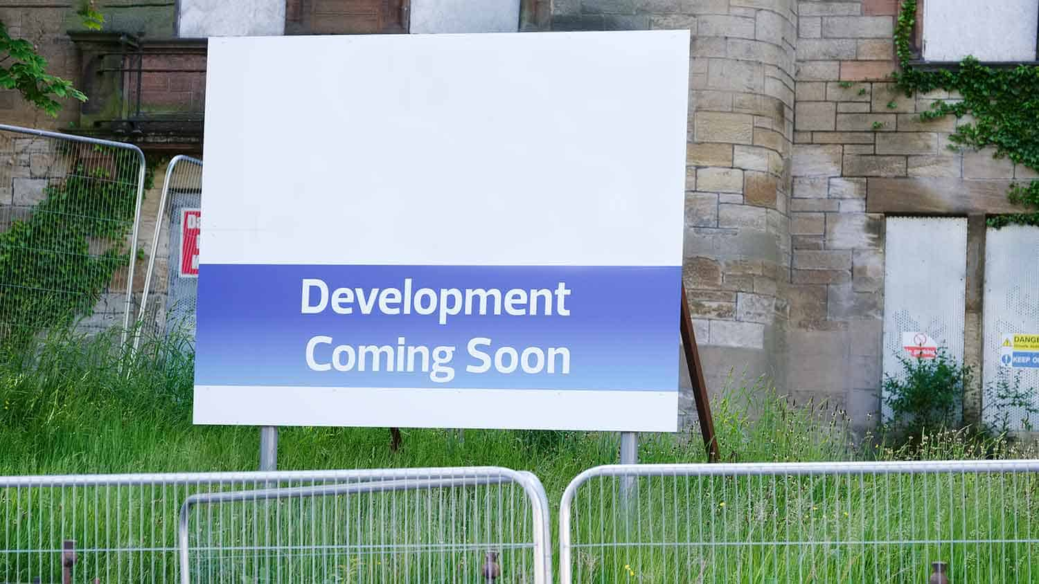 Housing development sign outside a building site