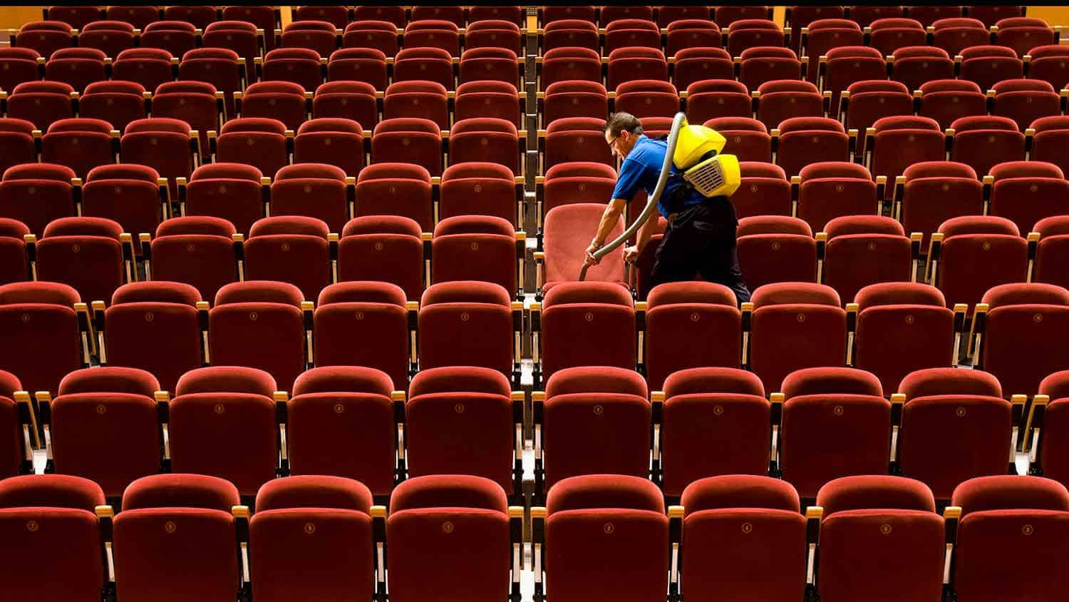 Empty theatre being cleaned