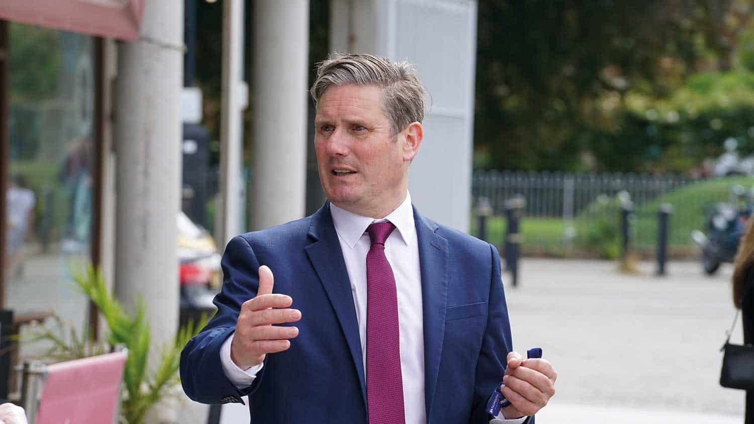 The Labour leader Sir Keir Starmer animate iwth his hands talking to someone off camera