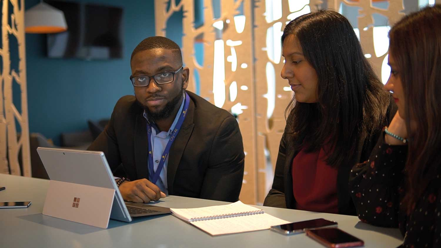 NGDP trainee looking at a computer with an assessor