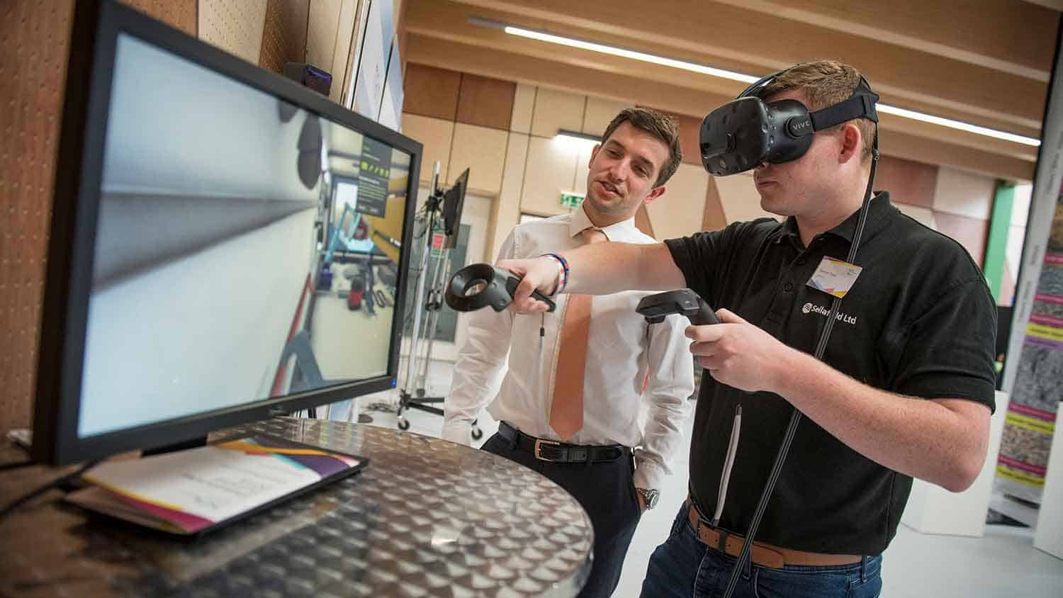 Someone being shown by a salesman a VR headset and controllers