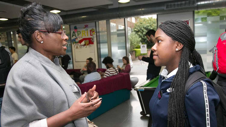 Cllr Bramble talking to a school pupil
