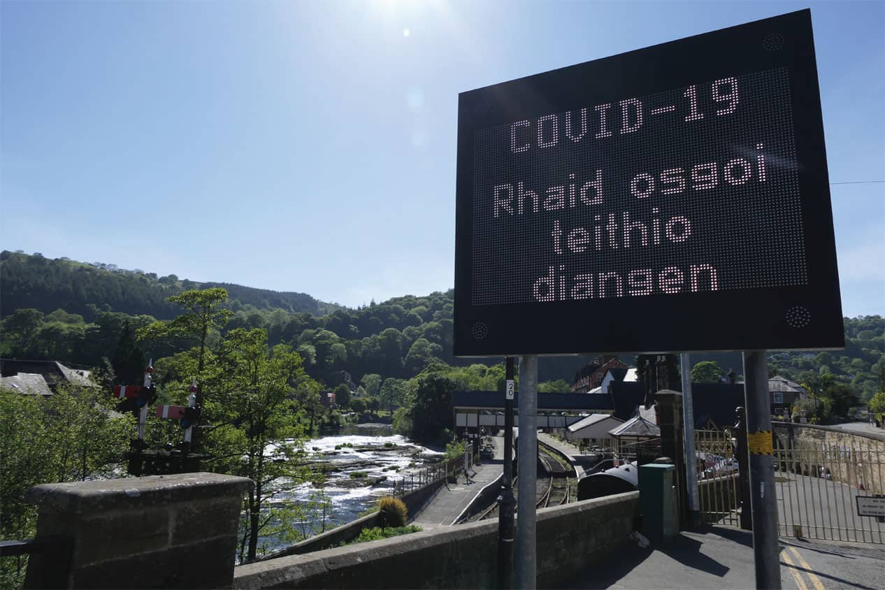 A traffic sign warning of COVID-19