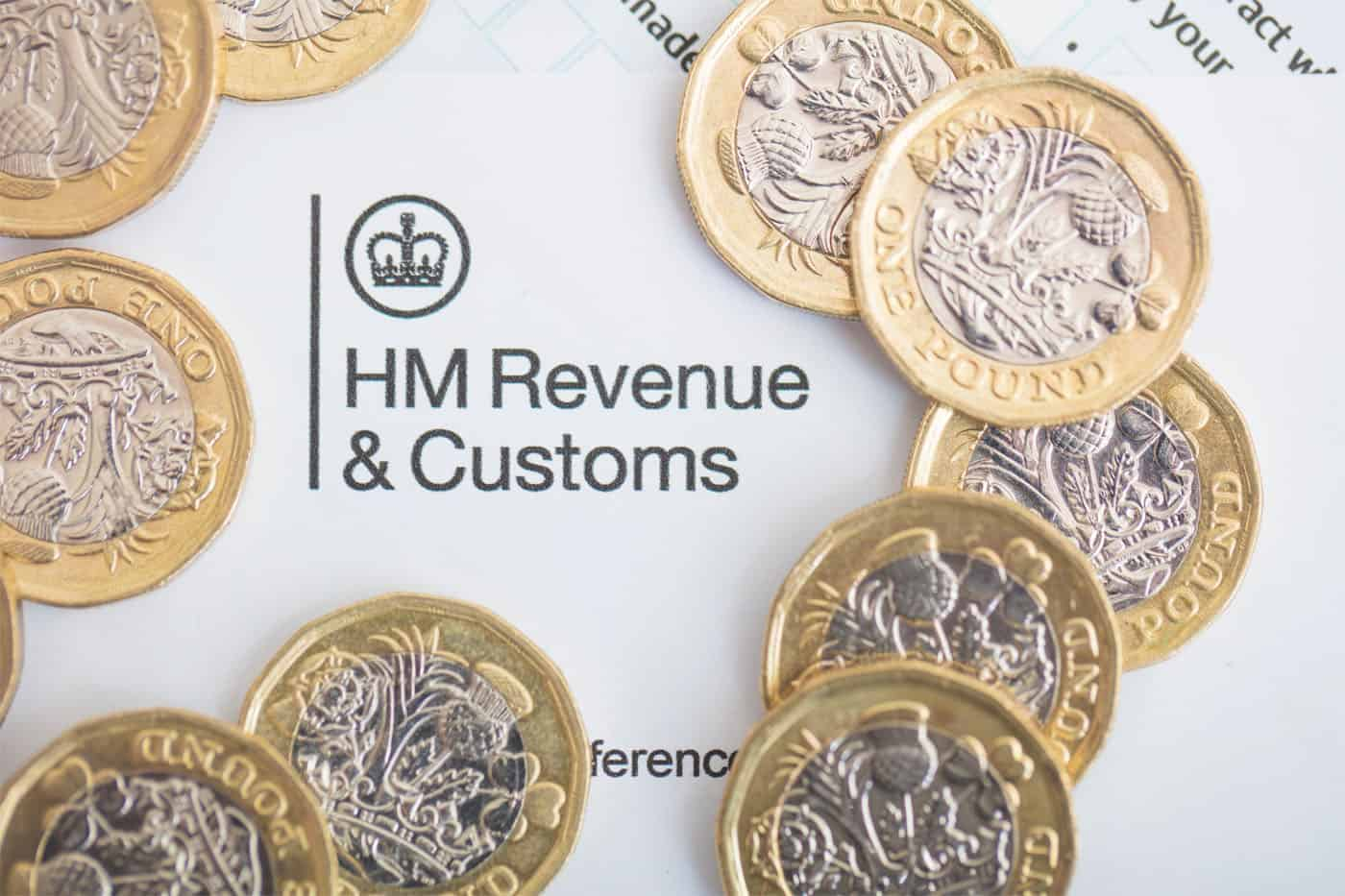 A circle of British pound coins around a HMRC letter