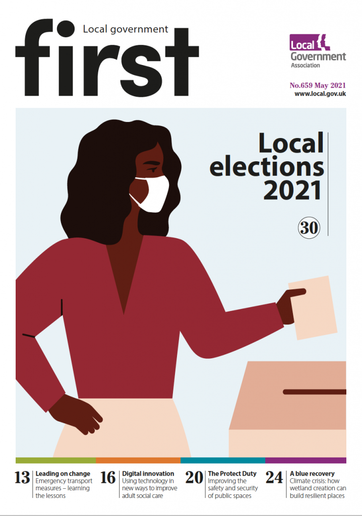 First May front cover - a woman dropping a ballot paper into a box