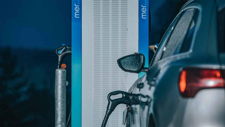 Car at an electric vehicle pump