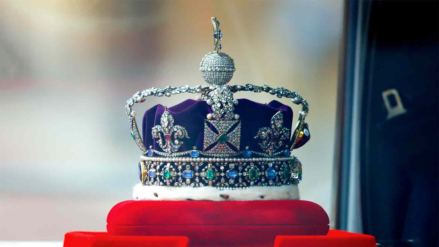 The crown jewels sat on a red velvet display unit