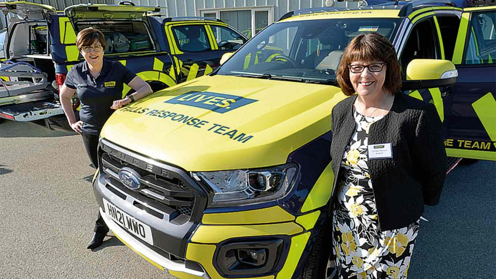 Councillor Patricia Bradwell stood in front of an ambulance