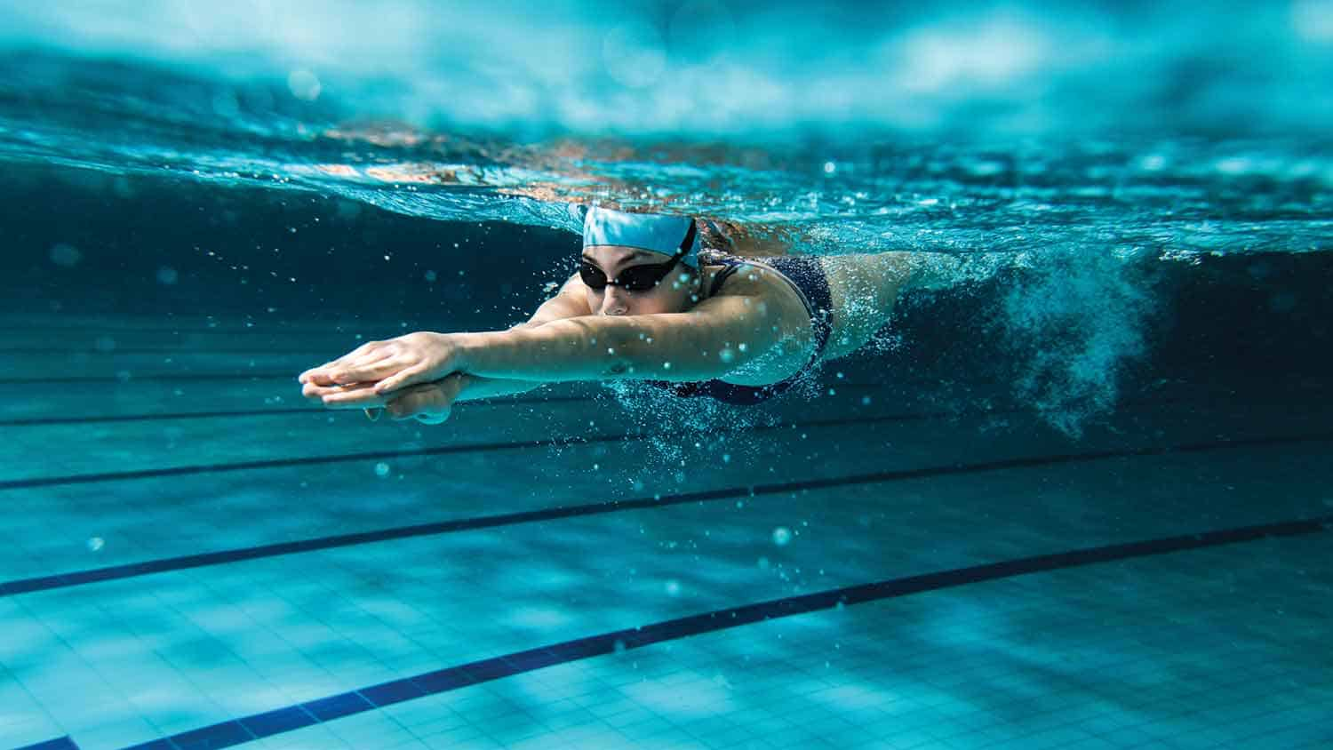 Swimmer under water, pushing off or diving in.