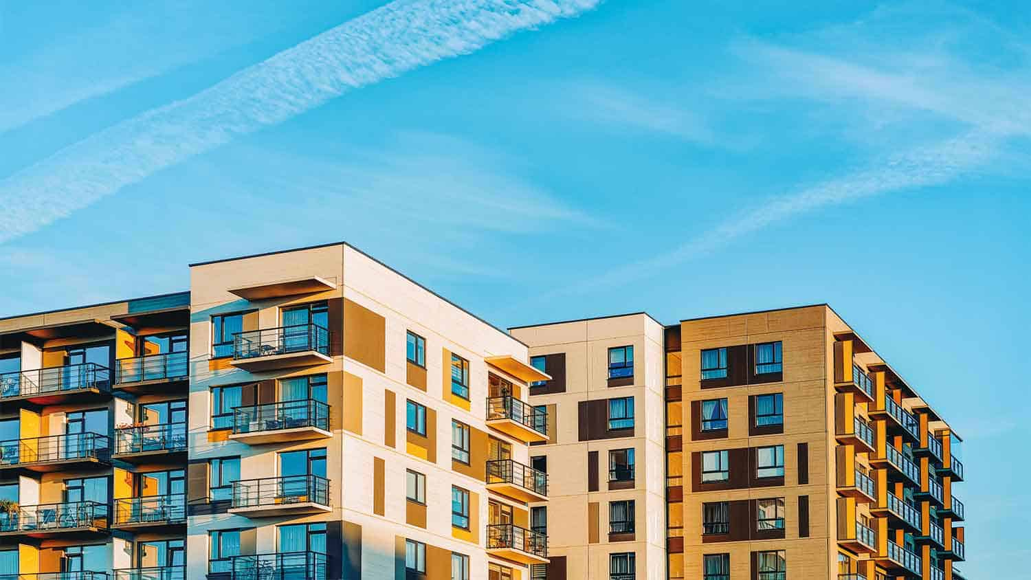 Apartment blocks with a blue sky background