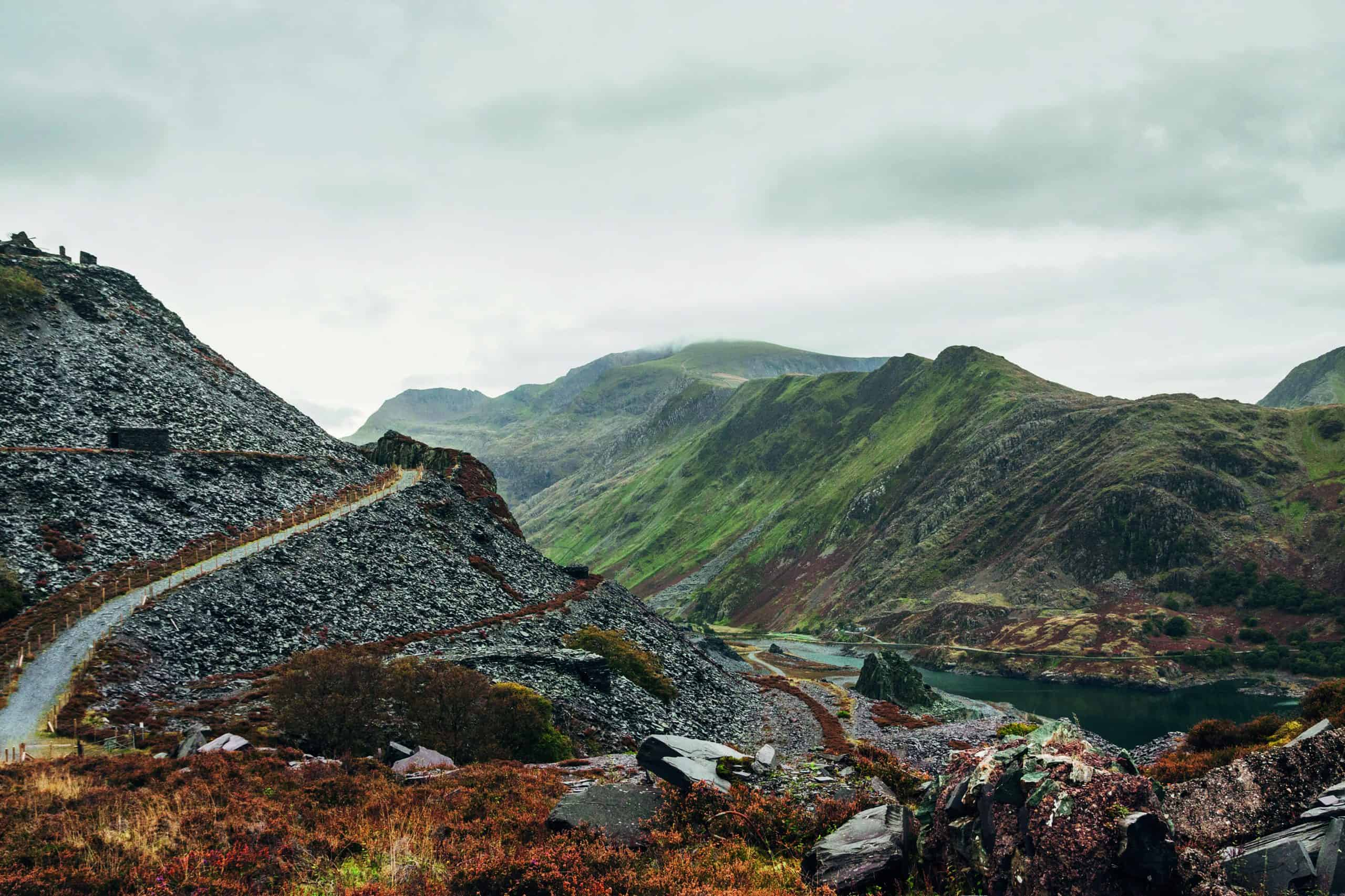 A slate quarry with Mount Snowdon in the background